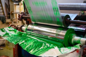 Commercial Pad Printing working to print green on plastic