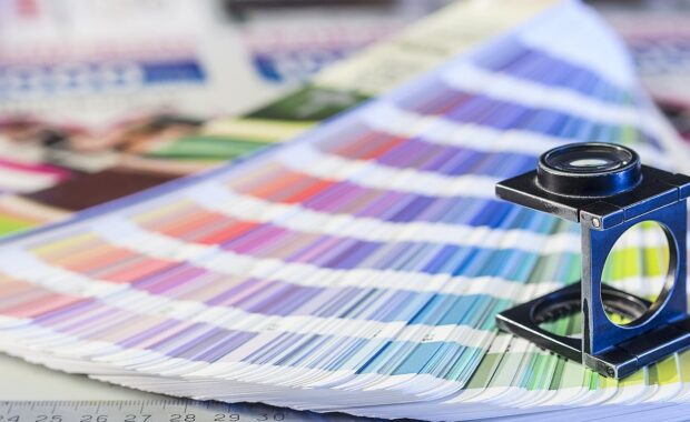 Magnifying glass and color swatches for color management in commercial printing process