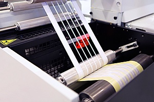 a commercial die cutting machine being used to create designs