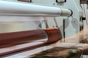 a commercial laminating machine that is working to laminate marketing collateral