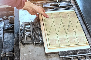 an individual performing commercial die cutting services