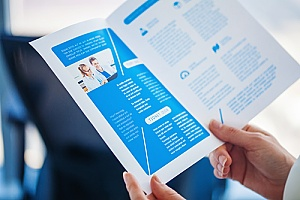 an individual reading a business brochure