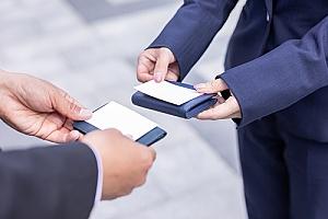entrepreneurs exchanging custom business cards