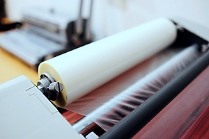 marketing material going through a commercial laminating machine