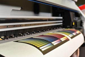 a wide format printer that a commercial printing company uses for projects