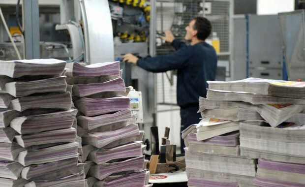 engineer checking machine in commercial printing company