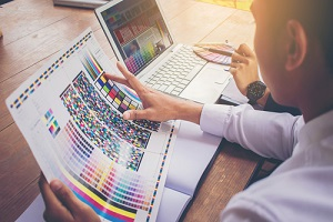 designer working graphic with color chart