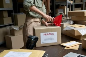 fulfillment company worker packing orders