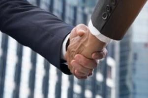 handshaking between two people