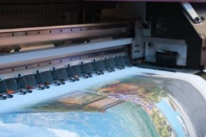 printing machine printing large scenery with Commercial Printing Services
