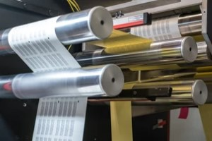 printinr machine rollers in action at a Commercial Printing Services