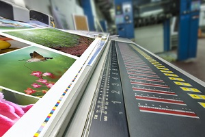 offset machine at a Commercial Sign Printing service working on printing a textbook