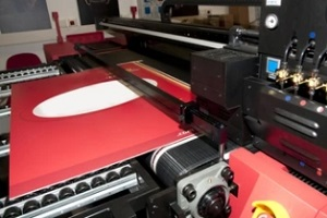 big printer printing sign in red color
